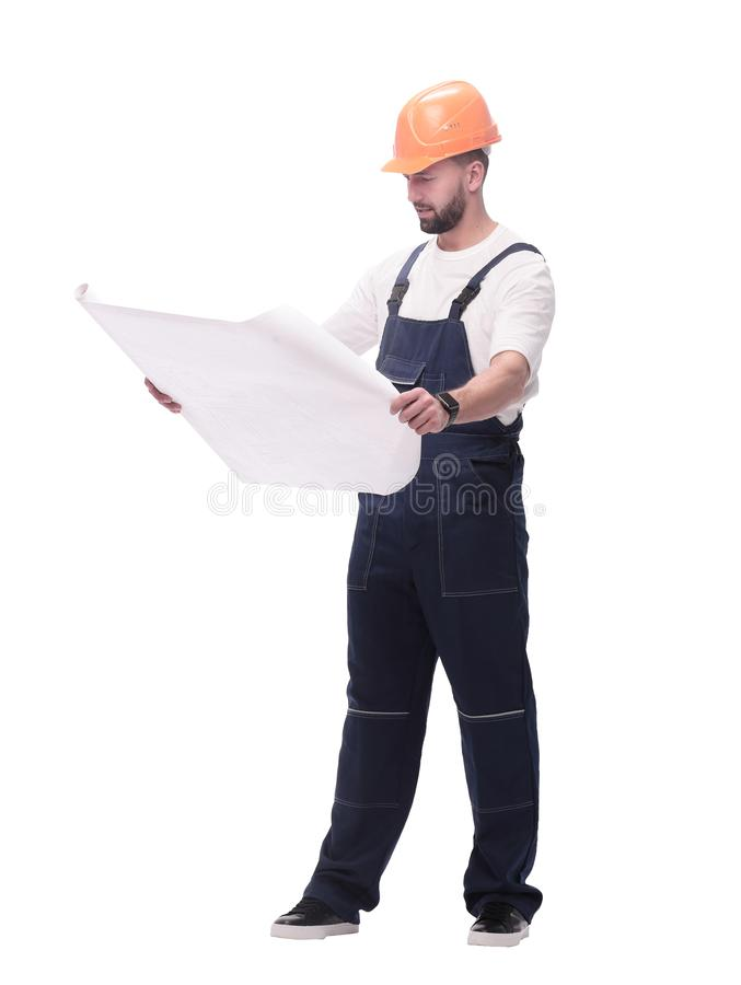 Competent foreman Builder looking at drawings. isolated on white. In full growth. competent foreman Builder looking at drawings. isolated on white background royalty free stock photo
