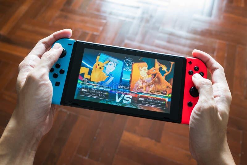 Competiam DX de Pokken no interruptor de Nintendo imagens de stock