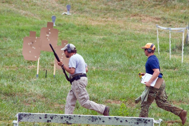 competición de la caridad 3-Gun fotos de archivo