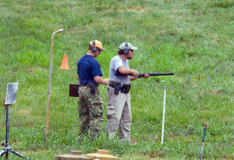competición de la caridad 3-Gun imagenes de archivo