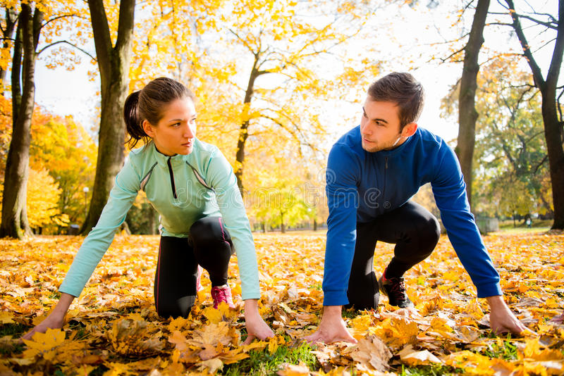 Competing couple prepared for run royalty free stock image