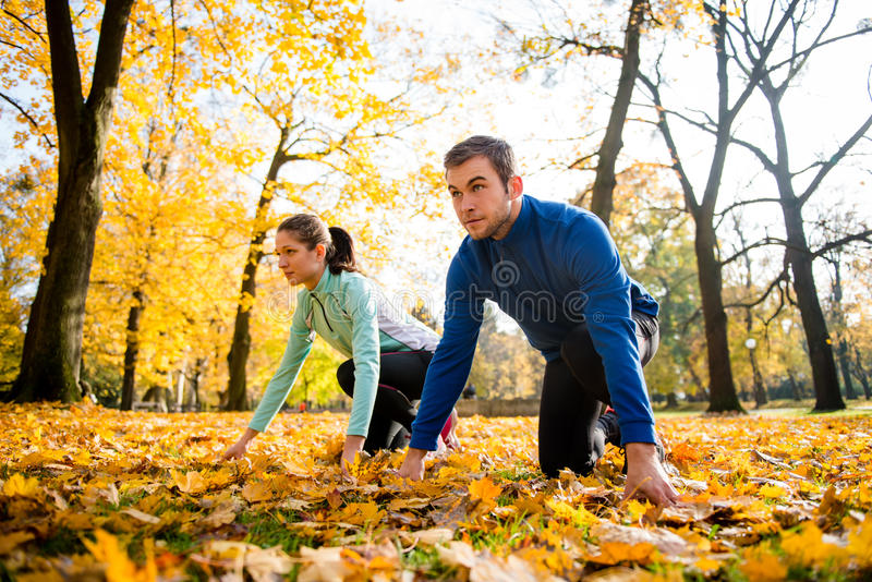 Competing couple prepared for run royalty free stock photos