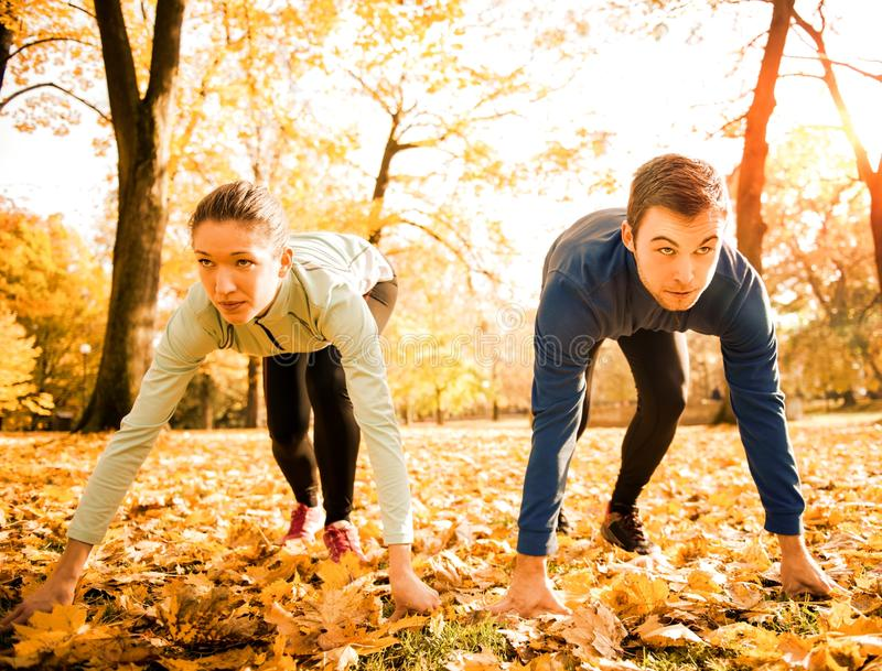 Competing couple prepared for run royalty free stock photography