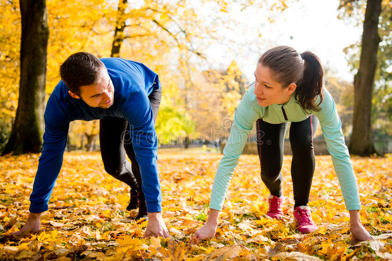 Competing couple prepared for run stock images