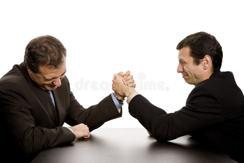 Competition. Two business men wrestling isolated on white background stock image