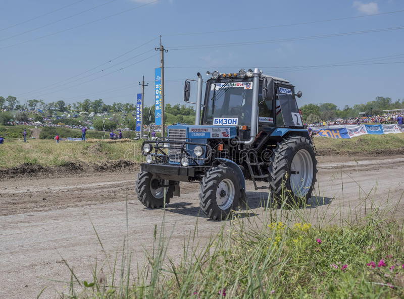 Competition for agricultural tractors on the green meadow. Bizo. Rostov-on-Don, Russia- June 05,2016: Competition for agricultural tractors on the green meadow royalty free stock photo