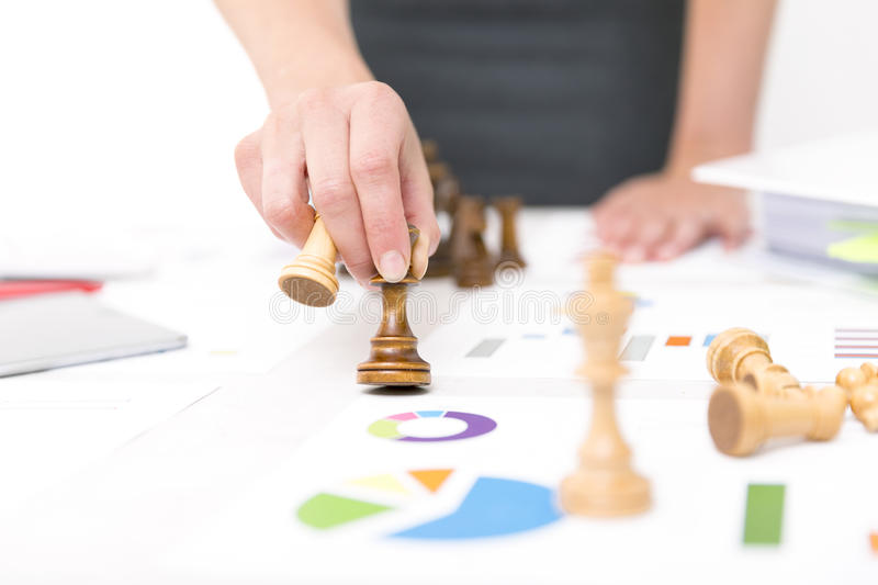 Competition concept. Competition and strategy in business. Business Woman is holding chess piece royalty free stock photography