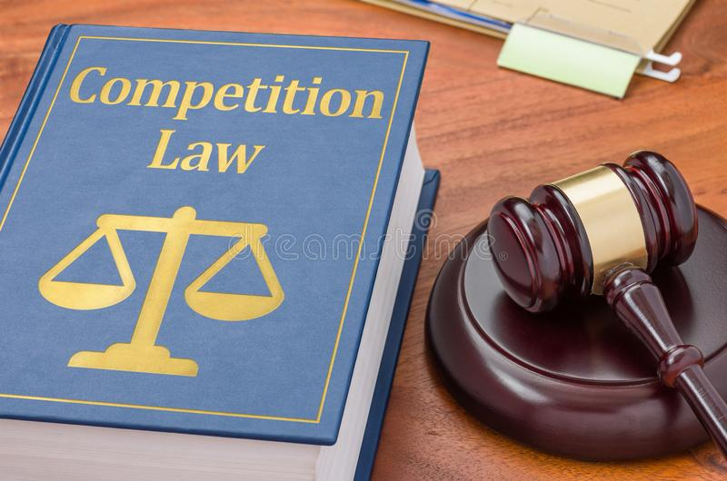 Competition law. A law book with a gavel - Competition law royalty free stock photography