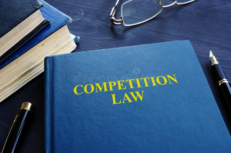 Competition law and pen on a table. royalty free stock image