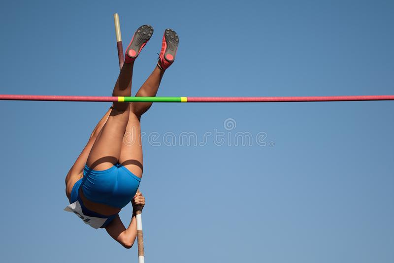 Competition pole vault jumper female royalty free stock images