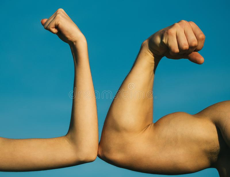 Competition, strength comparison. Vs. Fight hard. Health concept. Hand, man arm, fist. Musclar arm vs weak hand stock images