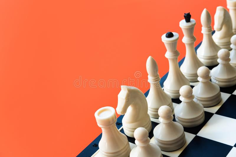 Competition or victory or strategy concept. Chess figures on blue background top view copy space. Competition or victory or strategy concept. Chess figures on stock photo