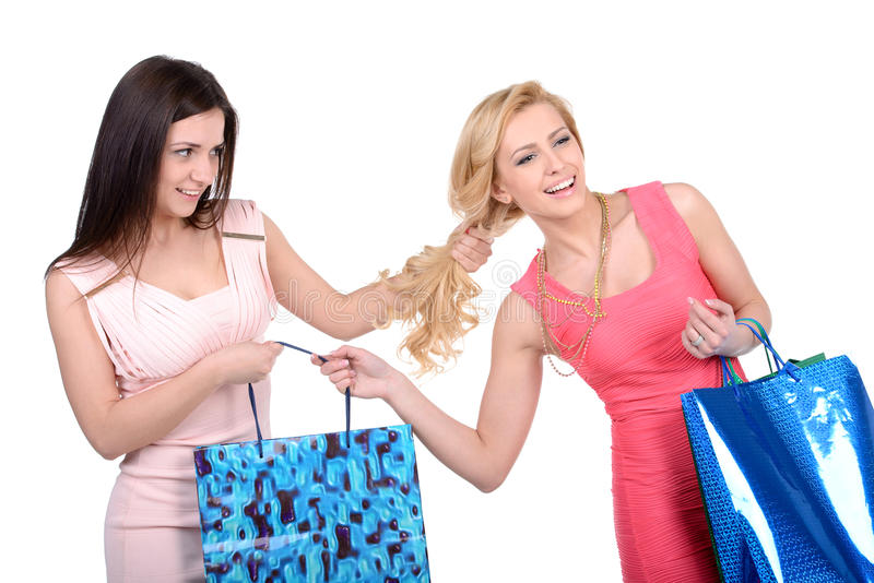 Competition. Women fighting. Two furious women fighting while standing isolated on white stock photography