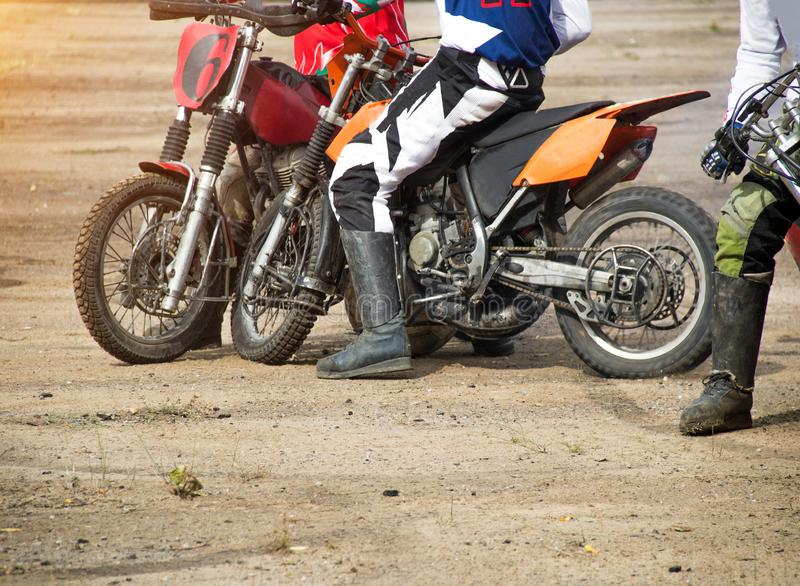Competitions on motoball, players are furiously fighting for the ball, playing football on motorcycles, motor bicycle. Competitions on motoball, players are stock images