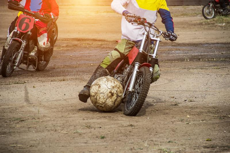 Competitions on motoball, players are furiously fighting for the ball, playing football on motorcycles, motor bicycle. Competitions on motoball, players are royalty free stock image