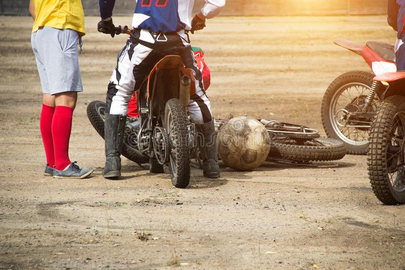Competitions on motoball, players are furiously fighting for the ball, playing football on motorcycles, motor bicycle. Competitions on motoball, players are royalty free stock photo