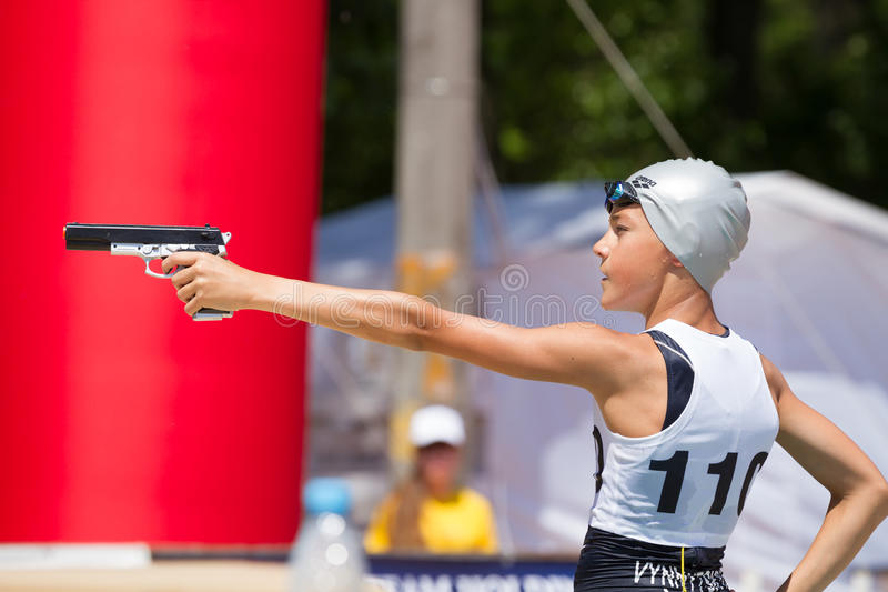 Competitions with shooting from a pneumatic pistol. KIEV, UKRAINE - JUNE 25, 2016: Competitions with shooting from a pneumatic pistol, running and swimming royalty free stock images