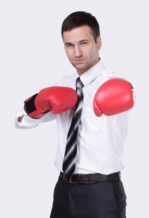 Competitive businessman in boxing gloves. stock photo