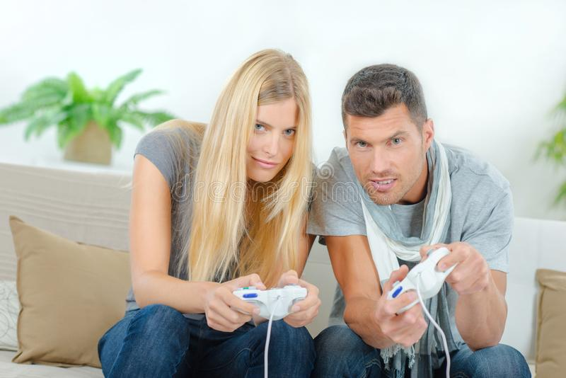 Competitive couple playing video games. Accomplice stock image