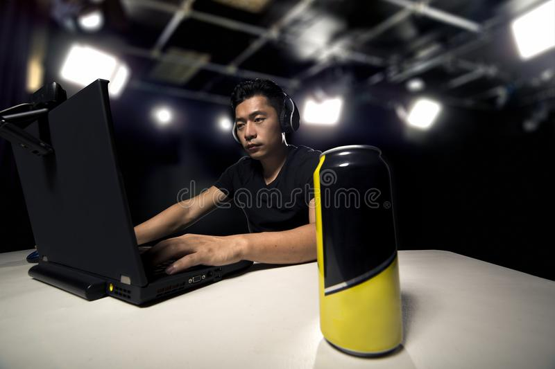 Energy Drink for eSport Gamer. Competitive eSport video game player drinking a canned energy drink as a stimulant. These beverage often contain caffeine and stock images