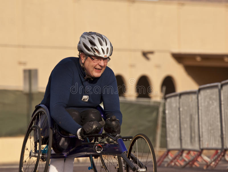 Competitor in the 2010 Phoenix Marathon. SCOTTSDALE, AZ - JANUARY 17: An unidentified wheelchair competitor races in the P.F. Chang's Phoenix Arizona Marathon on royalty free stock photography