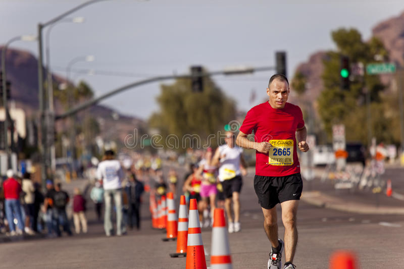 Competitor in the 2010 Phoenix Marathon. SCOTTSDALE, AZ - JANUARY 17: Raul Mewdieta leads a group of unidentified runners racing in the P.F. Chang's Phoenix stock photo