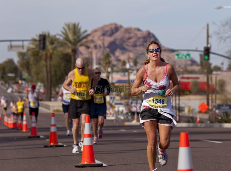 Competitor in the 2010 Phoenix Marathon. SCOTTSDALE, AZ - JANUARY 17: Jamie Tuchscherer racing in the P.F. Chang's Phoenix Arizona Marathon on January 17th 2010 stock image