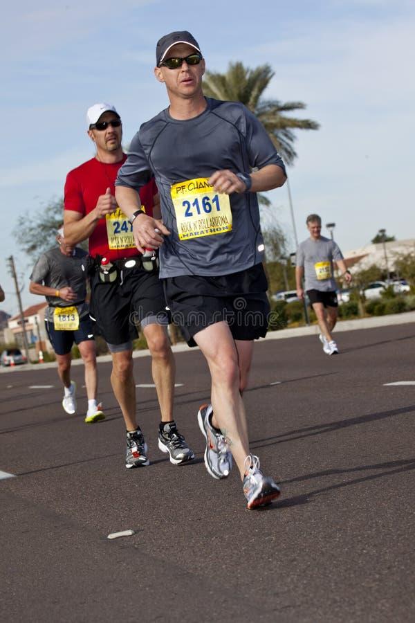 Competitor in the 2010 Phoenix Marathon. SCOTTSDALE, AZ - JANUARY 17: Marcus Ridgeway racing in the P.F. Chang's Phoenix Arizona Marathon on January 17th 2010 in stock images