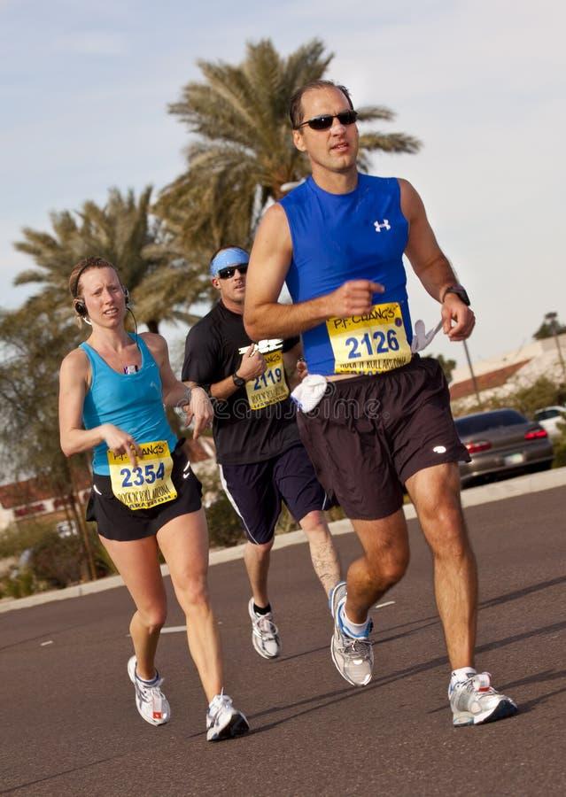 Competitor in the 2010 Phoenix Marathon. SCOTTSDALE, AZ - JANUARY 17: David Linville, Sarah Collatz and J Hill racing in the P.F. Chang's Phoenix Arizona stock image