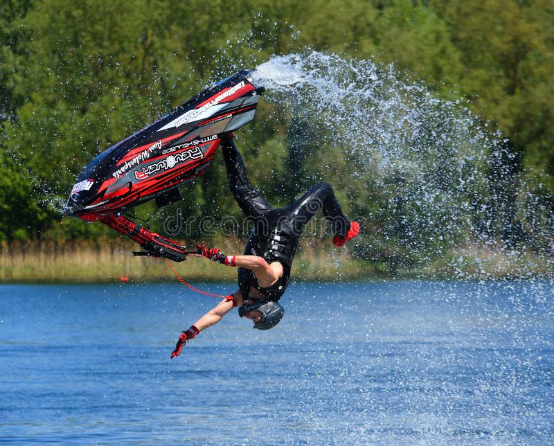 Competitor in freestyle Jet Ski competition at Ride Leisure Wyboston Lakes Bedfordshire. WYBOSTON, BEDFORDSHIRE, ENGLAND - MAY 12, 2019: competitor in freestyle stock image