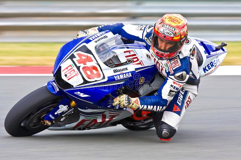 Competitor in motorbike race stock photos