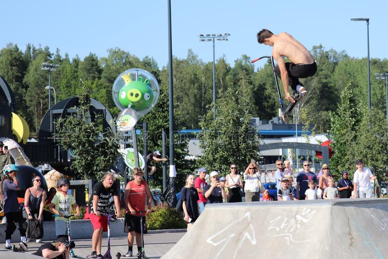 Competitor performing in National Scooter Championships 2019,  Pro-series. FinScooter Summer Jam sport event was held in Leppaevaara skate park in Espoo, Finland stock photo