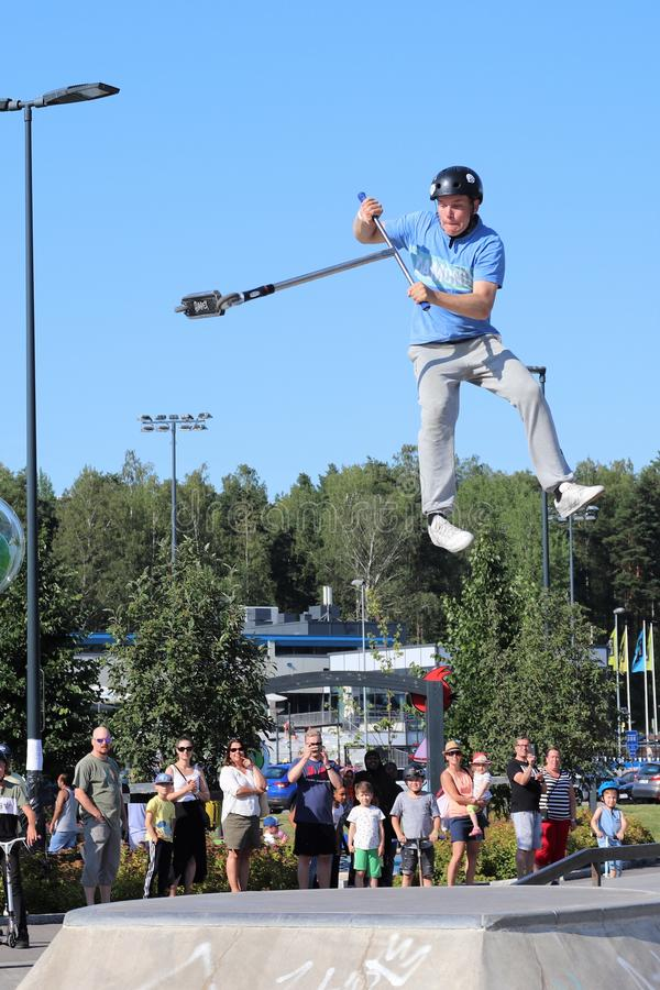 Competitor performing in National Scooter Championships 2019,  Pro-series. FinScooter Summer Jam sport event was held in Leppaevaara skate park in Espoo, Finland royalty free stock image