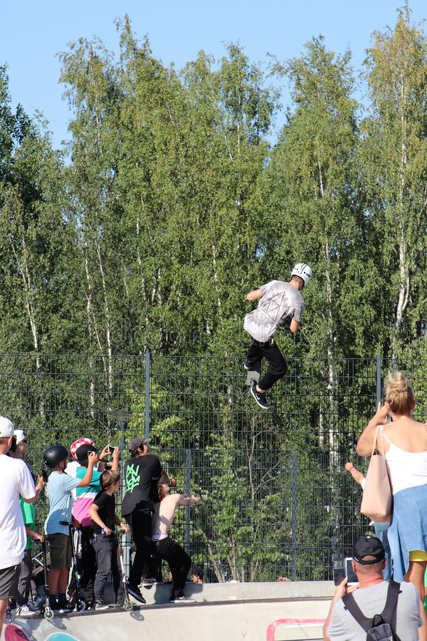 A competitor performing in Pro-series of Finnish Scooter Championships. FinScooter Summer Jam sport event was held in Leppaevaara skate park in Espoo, Finland stock images