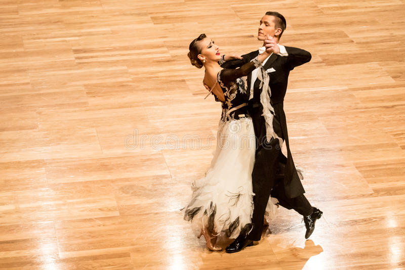 Competitors dancing slow waltz or tango. KOLOBRZEG, POLAND - FEBRUARY 27: Competitors dancing slow waltz at the Polish Championship in the ballroom standard stock image