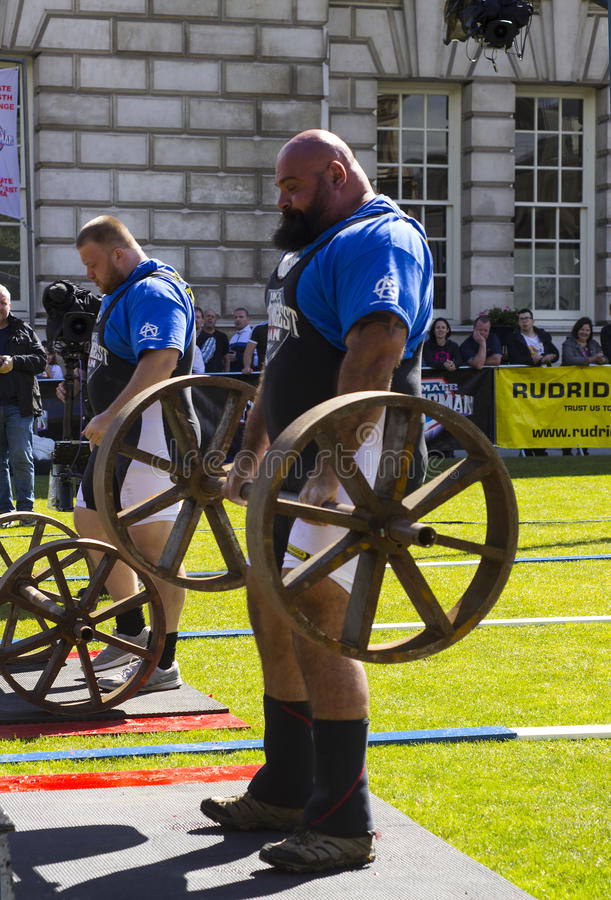 Competitors strain in the power lifting heat of the Ultimate Strongest Man competition. Competitors strain in the power lifting heat of the Ultimate Strongest royalty free stock images