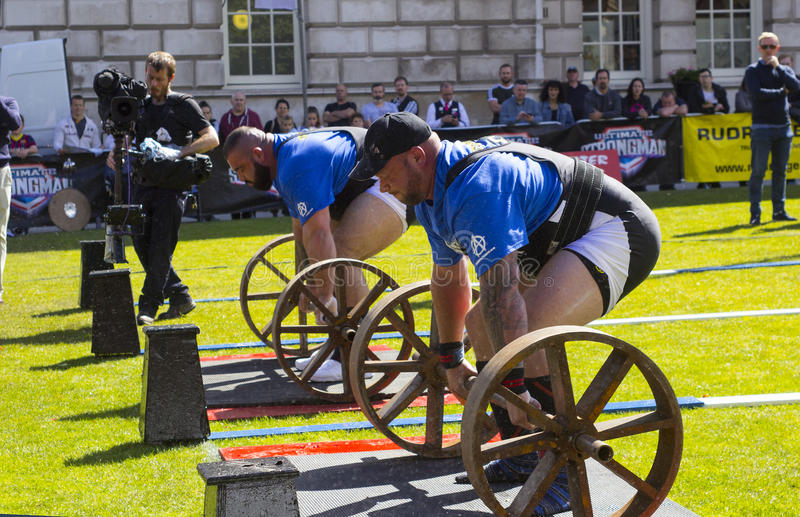 Competitors strain in the power lifting heat of the Ultimate Strongest Man competition. Competitors strain in the power lifting heat of the Ultimate Strongest stock image