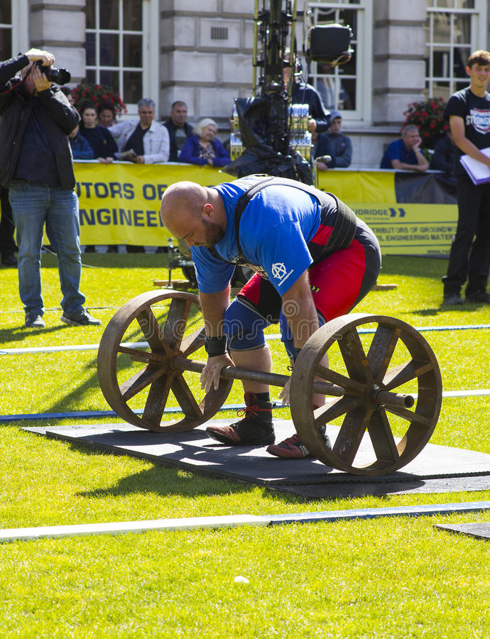 Competitors strain in the power lifting heat of the Ultimate Strongest Man competition. Competitors strain in the power lifting heat of the Ultimate Strongest stock photos