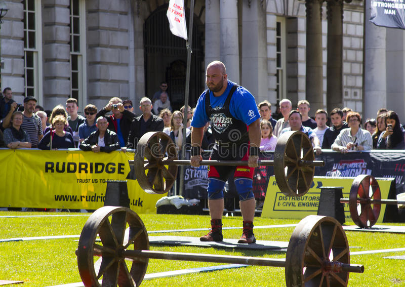 Competitors strain in the power lifting heat of the Ultimate Strongest Man competition. Competitors strain in the power lifting heat of the Ultimate Strongest royalty free stock photography