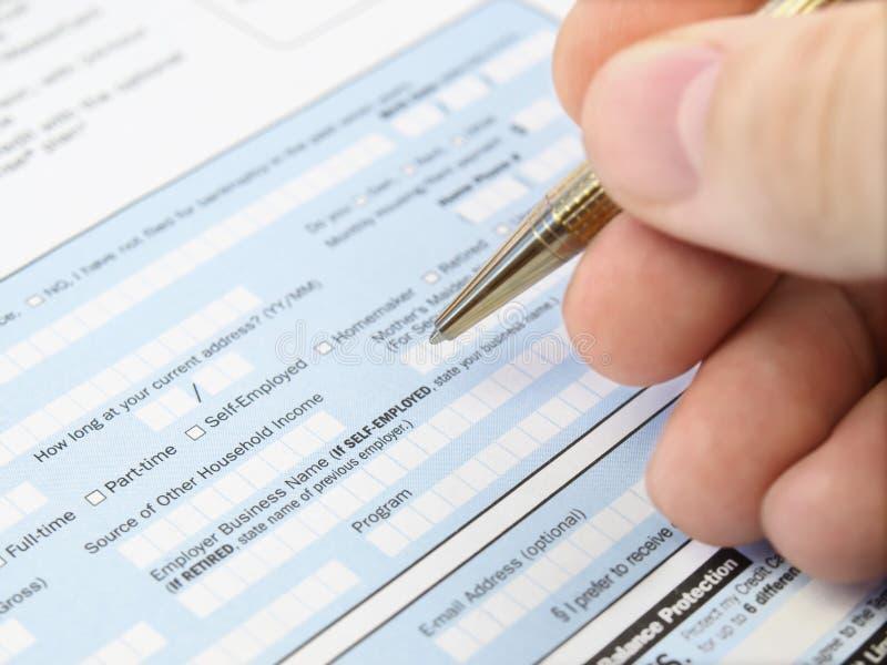 Compléter le formulaire de demande. photo libre de droits
