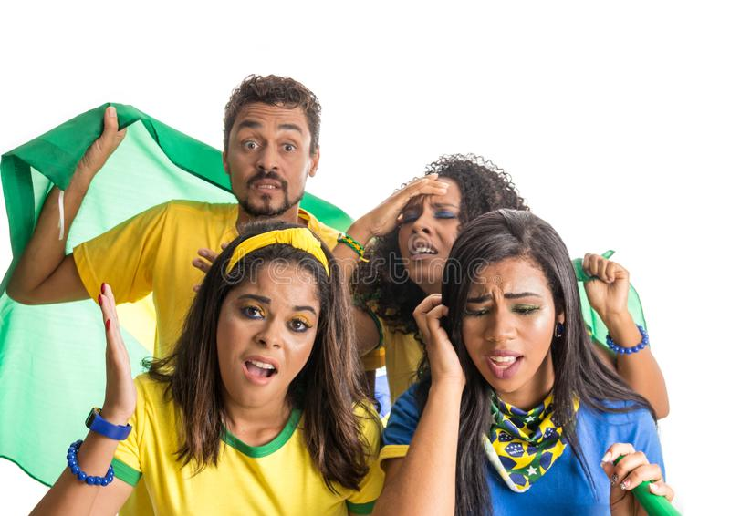 Brazilian group of fans celebrating on football match on white b stock photos