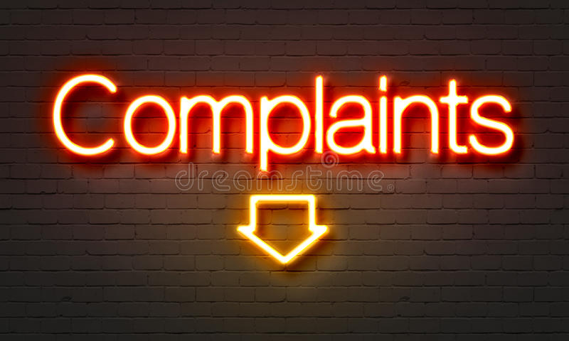 Complaints neon sign on brick wall background. royalty free stock images