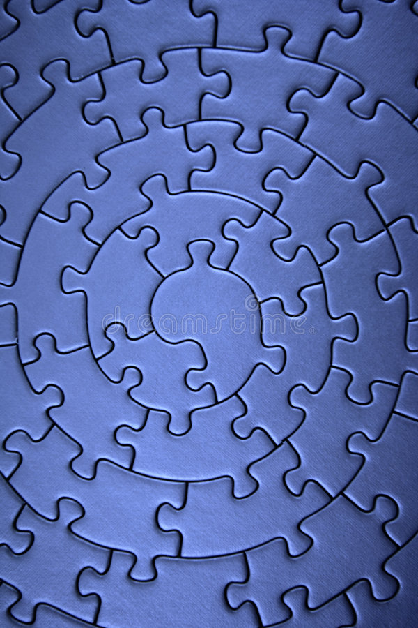 Complete blue jigsaw wide angle. Pieces fitting together in form of a spiral - adobe RGB stock photography