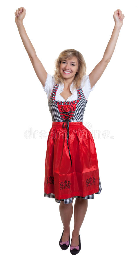 Complete body of a german woman in a traditional bavarian dirndl. On an isolated white background for cut out royalty free stock image