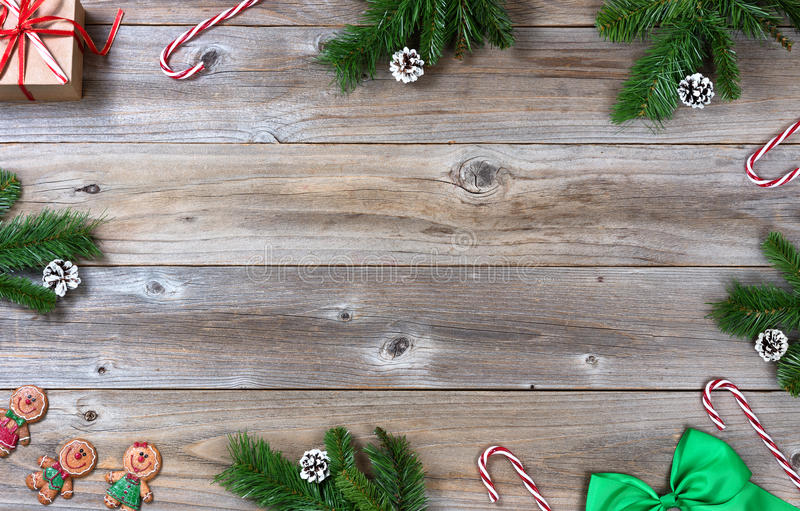 Complete Christmas border on rustic wooden boards. Complete border of a Christmas holiday objects on rustic wood stock image