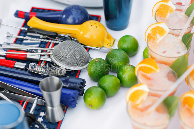 Complete cocktail set for bartender in blue. ime green and orange cocktails stock photography