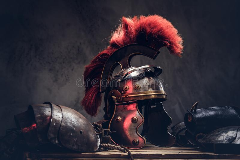 Complete combat equipment of the ancient Greek warrior lie on a box of wooden boards. royalty free stock photography