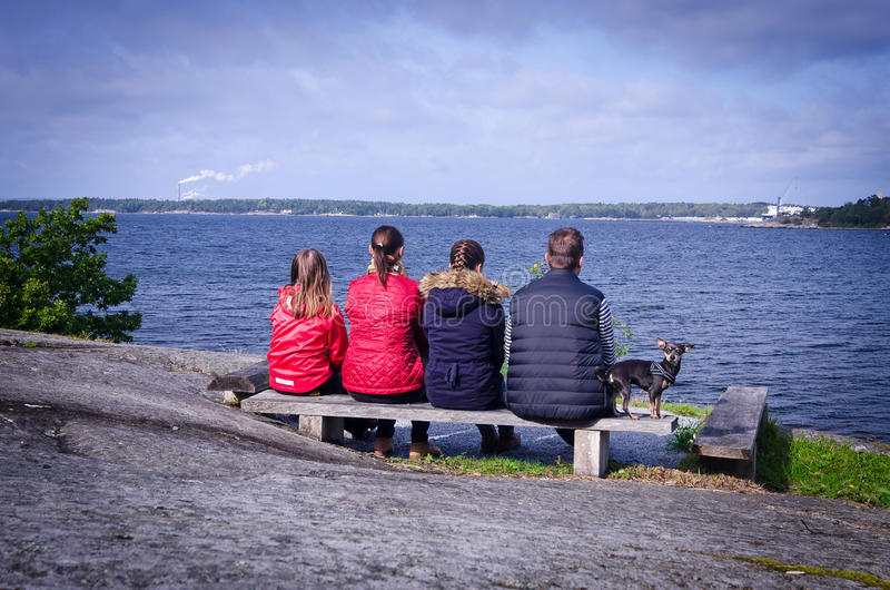 Complete family relaxing on sea coast royalty free stock photography