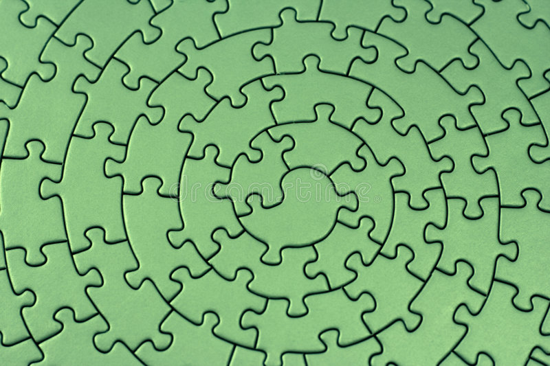 Complete green jigsaw. Pieces fitting together in form of a spiral - adobe RGB stock photography