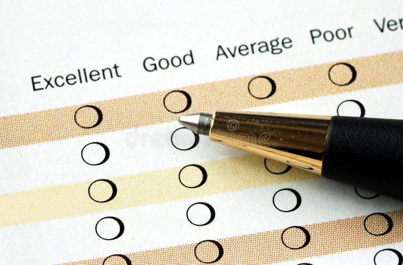 Complete la encuesta sobre la satisfacción imagen de archivo